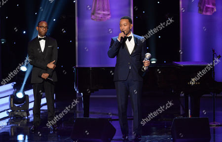 Cornell William Brooks, left, presents the president's award to John Legend at the 47th NAACP Image Awards at the Pasadena Civic Auditorium, in Pasadena, Calif