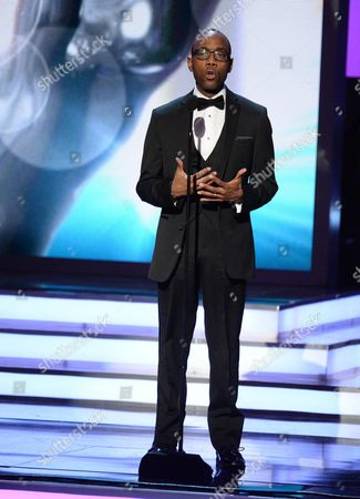 Cornell William Brooks presents the President's award to John Legend at the 47th NAACP Image Awards at the Pasadena Civic Auditorium, in Pasadena, Calif