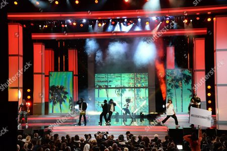 Chris Spencer (as Dr. Dre), from left, G-Thang (as MC Ren), Mitchell Marchand (as Eazy-E), Anthony Anderson (as Ice Cube) and Affion Crockett (as DJ Yella) perform during an NWA tribute at the 47th NAACP Image Awards at the Pasadena Civic Auditorium, in Pasadena, Calif