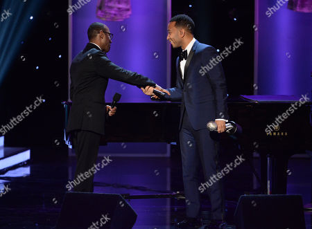 Cornell William Brooks, left, presents the presidentâ?™s award to John Legend at the 47th NAACP Image Awards at the Pasadena Civic Auditorium, in Pasadena, Calif