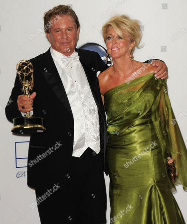 SEPTEMBER 23: Tom Berenger (L) and Laura Moretti pose in the press room at the Academy of Television Arts & Sciences 64th Primetime Emmy Awards at Nokia Theatre L.A. Live on in Los Angeles, California