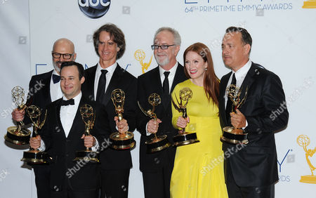 SEPTEMBER 23: (L-R) Producer Steven Shareshian, writer Danny Strong, director Jay Roach, producer Gary Goetzman, and actors Julianne Moore and Tom Hanks pose in the press room at the Academy of Television Arts & Sciences 64th Primetime Emmy Awards at Nokia Theatre L.A. Live on in Los Angeles, California
