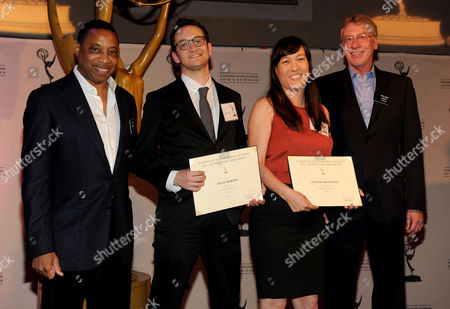 Stock Image of From left, Academy Governor Screech Washington, producers Dylan Morgan, Colleen McGuinness and Governor Steve Kent attend the Academy of Television Arts & Sciences Producer's Nominee Reception,, at the Montage Beverly Hills in Beverly Hills, Calif