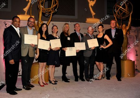 From left, Academy Governor Screech Washington, producers Scott Hornbacher, Erin Levy, Semi Chellas, Janet Leahy, Black McCormick, Matthew Weiner, Jessica Pare and Academy Governor Steve Kent attend the Academy of Television Arts & Sciences Producer's Nominee Reception,, at the Montage Beverly Hills in Beverly Hills, Calif