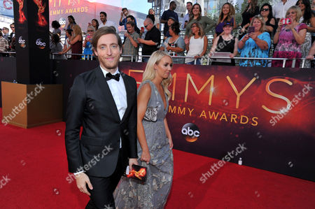 Thomas Middleditch, left, and Mollie Gates arrives at the 68th Primetime Emmy Awards, at the Microsoft Theater in Los Angeles