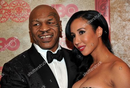 Mike Tyson, left, and Lakiha Spicer arrive at the HBO Golden Globes after party at the Beverly Hilton Hotel, in Beverly Hills, Calif
