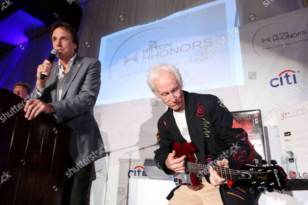 Kevin Nealon, left, and Robby Krieger auction off a guitar at the reception for the 8th Annual Hilton HHonors Charitable Golf Series Finale Event on in Los Angeles. The three-day event, held at the famed Riviera Country Club raised money for City of Hope, the leading research, treatment and education center for cancer, diabetes and other life-threatening diseases