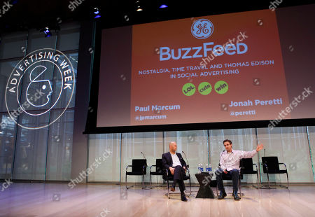 Paul Marcum, Director of Global Digital Marketing for GE, left, and Jonah Peretti, Founder and CEO of Buzzfeed, give a presentation at Advertising Week on in New York