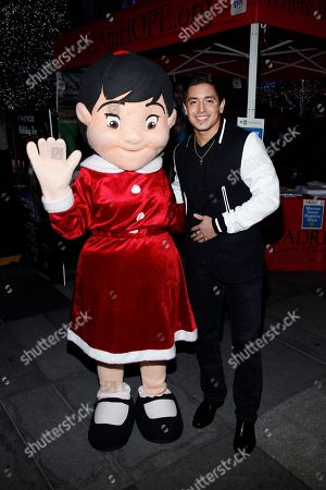 Stefano Langone and Padres Contra El Cancer mascot Esperanza attend the AEG Season of Giving honors Padres Contra El Cancer event on in Los Angeles