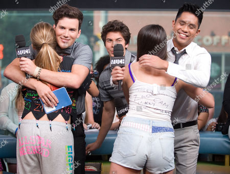 Musicians Cameron Quiseng and Michael Martinez of the band Allstar Weekend hug fans during an interview at New.Music.Live. at the MuchMusic HQ, in Toronto