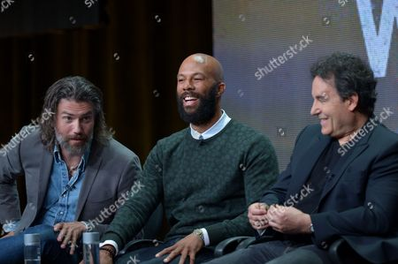 """Stock Photo of From left, actors Anson Mount, Common, and creator John Wirth on the """"Hell on Wheels"""" panel at AMC TCA Panel at the Beverly Hilton on Friday, June 26th, 2013 in Beverly Hills, Calif"""