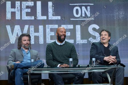 """IMAGE DISTRIBUTED FOR A&E - From left, actors Anson Mount, Common, and creator John Wirth on the """"Hell on Wheels"""" panel at AMC TCA Panel at the Beverly Hilton on Friday, June 26th, 2013 in Beverly Hills, Calif"""