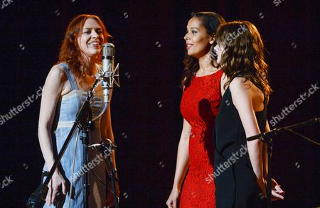 """Singers Gillian Welch, left, Rhiannon Giddens and actress Carey Mulligan, right, perform together during """"Another Day, Another Time: Celebrating the Music of Inside Llewyn Davis"""" at The Town Hall on in New York"""