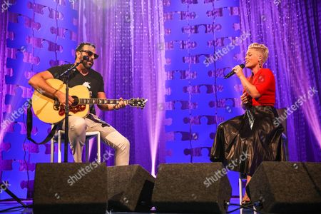 Billy Mann, left, and Pink perform at the Autism Speaks to LA Celebrity Chef Gala at Barker Hangar, in Santa Monica, Calif