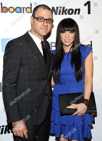 "Billboard editorial director, Bill Werde, poses with ""Rising Star"" honoree Carly Rae Jepsen at Billboard's ""Women in Music 2012"" luncheon at Capitale on in New York"