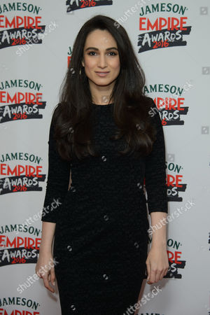 Asli Bayram poses for photographers upon arrival at the 'Empire Film Awards' in London