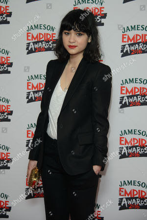 Isabella Laughland poses for photographers upon arrival at the 'Empire Film Awards' in London