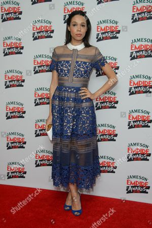 Vinette Robinson poses for photographers upon arrival at the 'Empire Film Awards' in London