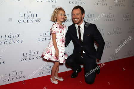 Actors Florence Clery and Michael Fassbender pose for photographers upon arrival at the premiere of the film 'The Light Between The Oceans', in London