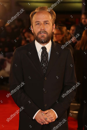 Derek Cianfrance poses for photographers upon arrival at the premiere of the film 'The Light Between The Oceans', in London