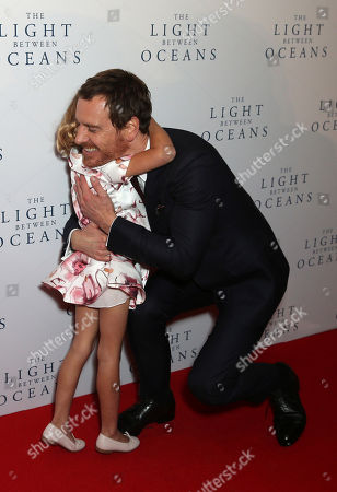 Actors Florence Clery and Michael Fassbender embrace upon arrival at the premiere of the film 'The Light Between The Oceans', in London