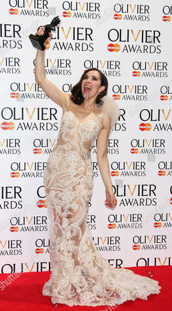 British actress Zrinka Cvitesic poses for photographers backstage with her award Best Actress in a Musical award for Once, during The Olivier Awards, at the Royal Opera House in London