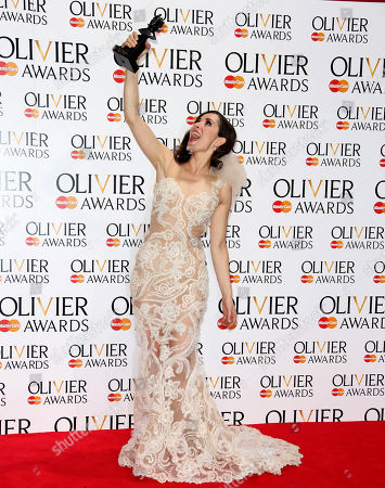 "British actress Zrinka Cvitesic poses for photographers backstage with her best actress in a musical award for ""Once,"" during The Olivier Awards, at the Royal Opera House in London"