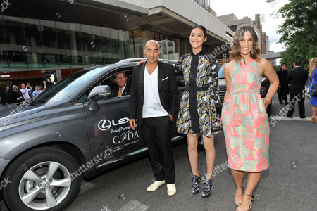 Suno designers Max Osterweis, left, and Erin Beatty, right, with model Liu Wen, arrive in a Lexus at the 2012 CFDA Fashion Awards, in New York