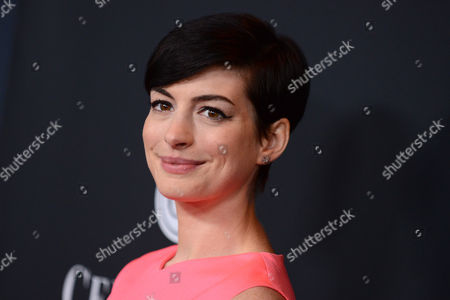 Actress Anne Hathaway arrives at Elyse Walker The Pink Party 2013 at Hangar 8 at the Santa Monica Airport on in Santa Monica, Calif