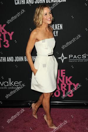 Actress Maria Bello arrives at Elyse Walker The Pink Party 2013 at Hangar 8 at the Santa Monica Airport on in Santa Monica, Calif