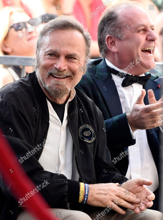Stock Picture of Italian actor Franco Nero, left, and Pascal Vicedomini look on during a ceremony presenting Italian composer Ennio Morricone with a star on the Hollywood Walk of Fame, in Los Angeles