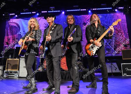 """James Young Musicians Tommy Shaw, left, Chuck Panozzo, James """"J.Y."""" Young and Ricky Phillips of the band Styx, perform at Eric Clapton's Crossroads Guitar Festival artist party at The Hard Rock Cafe New York on in New York"""