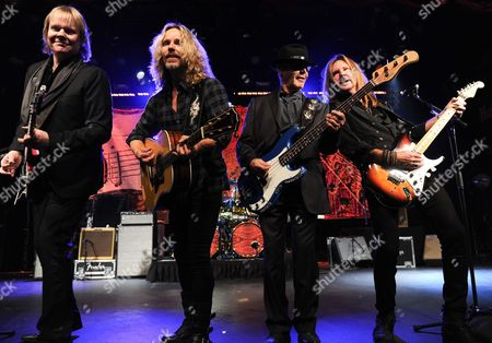 """James Young Musicians James """"J.Y."""" Young, left, Tommy Shaw, Chuck Panozzo and Ricky Phillips of the band Styx, perform at Eric Clapton's Crossroads Guitar Festival artist party at The Hard Rock Cafe New York on in New York"""