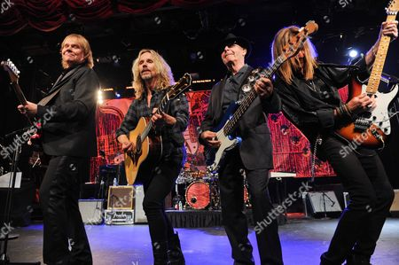 """Musicians James """"J.Y."""" Young, left, Tommy Shaw, Chuck Panozzo and Ricky Phillips of the band Styx, perform at Eric Clapton's Crossroads Guitar Festival artist party at The Hard Rock Cafe New York on in New York"""