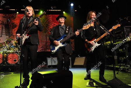 """Musicians James """"J.Y."""" Young, left, Chuck Panozzo, Ricky Phillips of the band Styx, perform at Eric Clapton's Crossroads Guitar Festival artist party at The Hard Rock Cafe New York on in New York"""