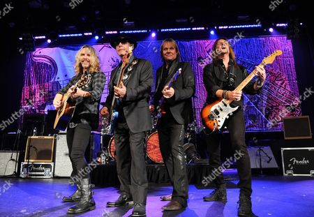 Musicians James Young, left, Tommy Shaw, Chuck Panozzo and Ricky Phillips of the band Styx, perform at Eric Clapton's Crossroads Guitar Festival artist party at The Hard Rock Cafe New York on in New York