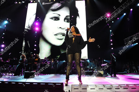 Nicci Gilbert performs a tribute to Whitney Houston at the Essence Music Festival in New Orleans on