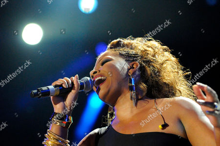 Syleena Johnson performs a tribute to Whitney Houston at the Essence Music Festival in New Orleans on
