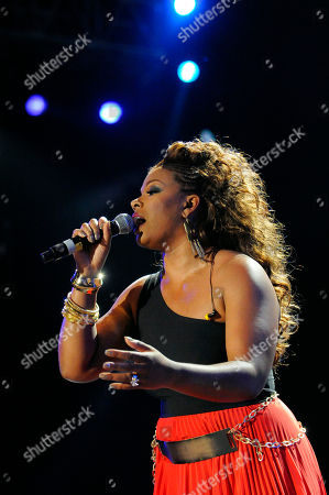Stock Picture of Syleena Johnson performs a tribute to Whitney Houston at the Essence Music Festival in New Orleans on