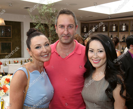 From left, Galina Sobolov, Single; Christos Garkinos, Decades and Christine Chiu, FGILA pose at Fashion Group International of Los Angeles luncheon to present a fashion scholarship fund honoring Ilse Metchek and the California Fashion Association held at Fig & Olive, in Los Angeles, Calif