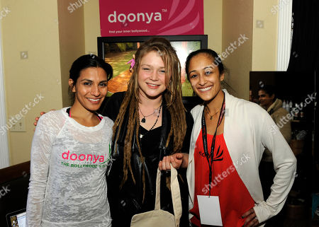 Musician Crystal Bowersox, center, visits the Doonya booth at the Fender Music lodge during the Sundance Film Festival, in Park City, Utah