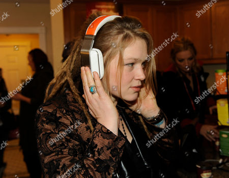 Musician Crystal Bowersox wears Inspiration headphones by Monster Products at the Fender Music lodge during the Sundance Film Festival, in Park City, Utah