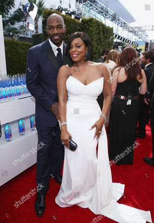 Jay Tucker, left and Niecy Nash arrive at the 68th Primetime Emmy Awards, at the Microsoft Theater in Los Angeles