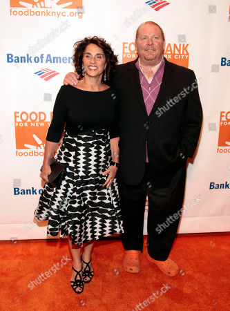 Stock Image of Restauranteur Mario Batali, right, with his wife Susi Cahn, left, attends the Food Bank of NYC Can Do Awards Benefit Gala, in New York
