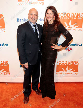 Restauranteur Tom Colicchio, left, with his wife, producer Lori Silverbush, right, attends the Food Bank of NYC Can Do Awards Benefit Gala, in New York