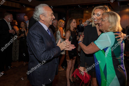 In this image distributed, from left, Eduardo DePandi, Giuliana Rancic and Anna DePandi seen at Giuliana Rancic 40th birthday surprise at the new RPM Steak Preview Party on Saturday, August 9, 2014 in Chicago