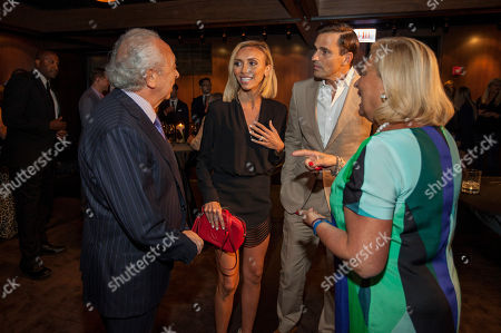 In this image distributed, from left, Eduardo DePandi, Giuliana Rancic, Bill Rancic and Anna DePandi seen at Giuliana Rancic 40th birthday surprise at the new RPM Steak Preview Party on Saturday, August 9, 2014 in Chicago