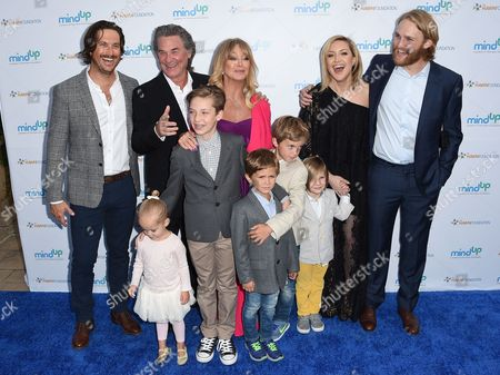 Oliver Hudson, from back row left, Kurt Russell, Goldie Hawn, Kate Hudson and Wyatt Russell, and from front row left, Rio Hudson, Ryder Robinson, Bodhi Hawn Hudson, Wilder Brooks Hudson and Bingham Hawn Bellamy arrive at Goldie's Love In For Kids, in Beverly Hills, Calif