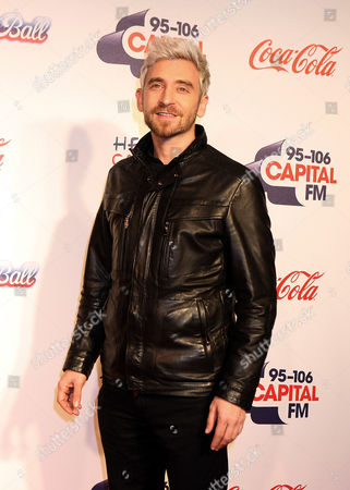 British DJ Fresh pose backstage at Capital FM's Jingle Bell Ball at the O2 Arena in London on