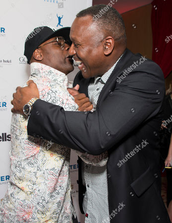 Maestro Fresh Wes and Joe Carter seen on the red carpet at the Joe Carter Classic after party at the Shangri-La Hotel, in Toronto, Canada
